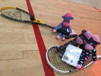 The sock monkeys try their hand at squash